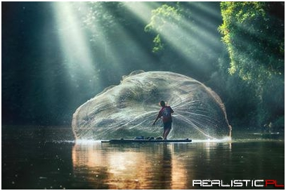 Fisherman casting his net